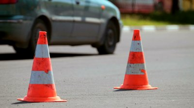 stock-footage-traffic-cone-in-the-background-moving-cars